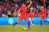 ORLANDO, FL - NOVEMBER 15: Aaron Long #3 of the United States sends a ball downfield during a game between Canada and USMNT at Exploria Stadium on November 15, 2019 in Orlando, Florida.