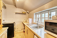 BNPS.co.uk (01202 558833)<br /> Pic: PropertyPublicity/BNPS<br /> <br /> Pictured: The kitchen<br /> <br /> Loco-cation, loco-cation, loco-cation..<br /> <br /> This quirky property that is up for sale is all about its loco-cation - as it sits on a railway crossing right next to the train tracks.<br /> <br /> The Grade II listed cottage was built in 1850 to house the gatekeeper whose job it was to close the gates at the road crossing whenever a train was due.<br /> <br /> The gates, in the village of Stone, Staffs, were automated many years ago.