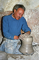 Tunisia, Nabeul.  Tunisian Potter at Work in his Workshop.