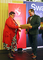 Pictured L-R: Labour candidate for Swansea East constituency Carolyn Harris accepts the results by returning officer Huw Evans.  Friday 09 June 2017<br /> Re: Counting of ballots at Brangwyn Hall for the general election in Swansea, Wales, UK