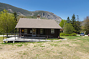 Cannon Mountain from Lafayette Place in Franconia Notch, New Hampshire during the spring months. The scenic Franconia Notch Bike Path travels pass this cabin.