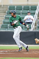 Rafael Rodriguez (14) of the Augusta GreenJackets follows through on his swing against the Kannapolis Intimidators at CMC-NorthEast Stadium on July 31, 2014 in Kannapolis, North Carolina.  The Intimidators defeated the GreenJackets 4-3.  (Brian Westerholt/Four Seam Images)