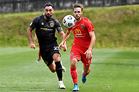Luke Tongue of Canterbury United competes for the ball with Rory McKeown of Team Wellington during the ISPS Handa Men's Premiership - Team Wellington v Canterbury Utd at David Farrington Park, Wellington on Saturday 19 December 2020.<br /> Copyright photo: Masanori Udagawa /  www.photosport.nz