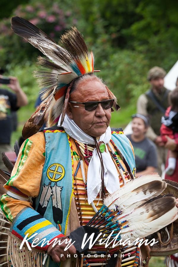 Native American Man wearing Feather Headdress, Northwest Folklife Festival 2015, Seattle Center, Washington, USA.