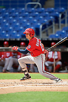 Washington Nationals Jacob Rhinesmith (28) follows through on a swing during a Florida Instructional League game against the Miami Marlins on September 26, 2018 at the Marlins Park in Miami, Florida.  (Mike Janes/Four Seam Images)
