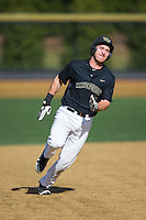 Ben Breazeale (9) of the Wake Forest Demon Deacons hustles towards third base against Florida State Seminoles the at David F. Couch Ballpark on April 16, 2016 in Winston-Salem, North Carolina.  The Seminoles defeated the Demon Deacons 13-8.  (Brian Westerholt/Four Seam Images)