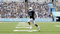 CHAPEL HILL, NC - OCTOBER 10: Dazz Newsome #5 of North Carolina scores a touchdown on a 6-yard run during a game between Virginia Tech and North Carolina at Kenan Memorial Stadium on October 10, 2020 in Chapel Hill, North Carolina.