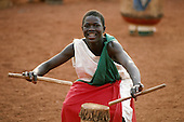 Burundi. Drummer holding drum sticks and dancing with his drum from a traditional Burundi group.