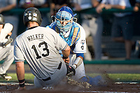 UCLA catcher Steve Rodriguez tags out South Carolina's Christian Walker in Game One of the NCAA Division One Men's College World Series Finals on June 28th, 2010 at Johnny Rosenblatt Stadium in Omaha, Nebraska.  (Photo by Andrew Woolley / Four Seam Images)