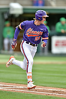 Clemson Tigers third baseman Patrick Cromwell (25) runs to first base during a game against the Notre Dame Fighting Irish at Doug Kingsmore Stadium on March 11, 2017 in Clemson, South Carolina. The Tigers defeated the Fighting Irish 6-5. (Tony Farlow/Four Seam Images)