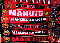Manchester United scarves back on display outside Old Trafford as the kiosks and market stalls reopen as thirty thousand fans are expected for the match during Manchester United vs Brentford, Friendly Match Football at Old Trafford on 28th July 2021