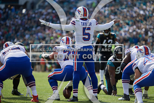 Buffalo Bills quarterback Tyrod Taylor (5) directs the offense during an NFL Wild-Card football game against the Jacksonville Jaguars, Sunday, January 7, 2018, in Jacksonville, Fla.  (Mike Janes Photography)