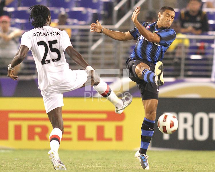 Ivan Cordoba #2 of Inter Milan boots the ball away from Emmanuel Adebayor #25 of Manchester City during an international friendly match on July 31 2010 at M&T Bank Stadium in Baltimore, Maryland. Milan won 3-0.