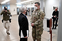 Sen. Jack Reed (D-R.I.) speaks to a National Guardsman as he arrives at the Capitol on Wednesday, February 10, 2021 for the second day of the impeachment trial of former President Donald Trump.<br /> CAP/MPI/RS<br /> ©RS/MPI/Capital Pictures