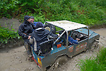 Land Rover based off-road racer at the ALRC National 2008 CCVT trial driving through flooded forest road to next section after torrential rain. The Association of Land Rover Clubs (ALRC) National Rallye is the biggest annual motor sport oriented Land Rover event and was hosted 2008 by the Midland Rover Owners Club at Eastnor Castle in Herefordshire, UK, 22 - 27 May 2008. --- No releases available. Automotive trademarks are the property of the trademark holder, authorization may be needed for some uses.