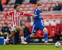 9th January 2021; Bet365 Stadium, Stoke, Staffordshire, England; English FA Cup Football, Carabao Cup, Stoke City versus Leicester City; Harvey Barnes of Leicester City under pressure from Jacob Brown of Stoke City