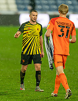 19th December 2020 The John Smiths Stadium, Huddersfield, Yorkshire, England; English Football League Championship Football, Huddersfield Town versus Watford; Tom Cleverley of Watford congratulates Ryan Schofield on his performance and win for Huddersfield