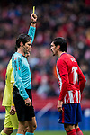 Referee Jose Luis Munuera Montero (L) shows Stefan Savic of Atletico de Madrid the yellow card during the La Liga 2017-18 match between Atletico de Madrid and Getafe CF at Wanda Metropolitano on January 06 2018 in Madrid, Spain. Photo by Diego Gonzalez / Power Sport Images