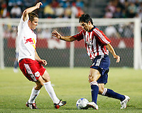 Chivas USA forward, Ante Razov(9) puts a move on  NY Red Bulls defender, Hunter Freeman(3) during the 1st half. Chivas USA  took on the NY Red Bulls on June 28, 2008 at the Home Depot Center in Carson, CA. The game ended in a 1-1 tie...