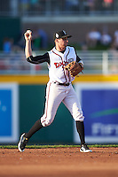Lansing Lugnuts second baseman Tim Locastro (4) throws to first during a game against the Peoria Chiefs on June 6, 2015 at Cooley Law School Stadium in Lansing, Michigan.  Lansing defeated Peoria 6-2.  (Mike Janes/Four Seam Images)