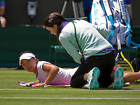 England, London, 25.06.2014. Tennis, Wimbledon, AELTC, Kurimi Nara (JPN) gets a fysio treatment<br /> Photo: Tennisimages/Henk Koster