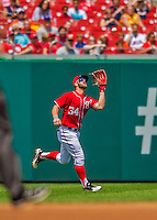 28 July 2013: Washington Nationals outfielder Bryce Harper pulls in a fly ball during a game against the New York Mets at Nationals Park in Washington, DC. The Nationals defeated the Mets 14-1. Mandatory Credit: Ed Wolfstein Photo *** RAW (NEF) Image File Available ***