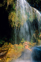 woman showering under the Sai Yok Yai waterfall, River Kwai Noi, Kanchanaburi, Thailand, Andaman Sea, Indian Ocean