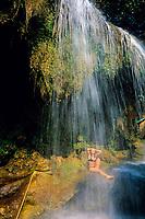 woman showering under the Sai Yok Yai waterfall, River Kwai Noi, Kanchanaburi, Thailand, Andaman Sea, Indian Ocean