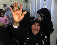 """Palestinian women react during the funeral of Hamas militant Ghassan Al-ailah, 22, who was killed by Israeli forces, in the Jebaliya refugee camp, northern Gaza Strip, Tuesday, Nov. 27, 2007. The leader of the Gaza Strip's Hamas government on Tuesday sent a defiant message to the Mideast peace conference under way in the U.S., saying it is """"doomed to failure"""" and warning that his Islamic militant group will not lay down its arms. The comments by Ismail Haniyeh were the latest in a string of increasingly hostile criticism of the Annapolis peace conference by Hamas officials.(.""""photo by Fady Adwan"""""""