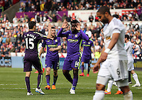 SWANSEA, WALES - MAY 17: Wilfried Bony of Manchester City (C) celebrates his winning goal with team mate Jesus Navas during the Premier League match between Swansea City and Manchester City at The Liberty Stadium on May 17, 2015 in Swansea, Wales. (photo by Athena Pictures/Getty Images)