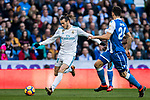 Gareth Bale (L) of Real Madrid fights for the ball with RC Deportivo La Coruna's players during the La Liga 2017-18 match between Real Madrid and RC Deportivo La Coruna at Santiago Bernabeu Stadium on January 21 2018 in Madrid, Spain. Photo by Diego Gonzalez / Power Sport Images