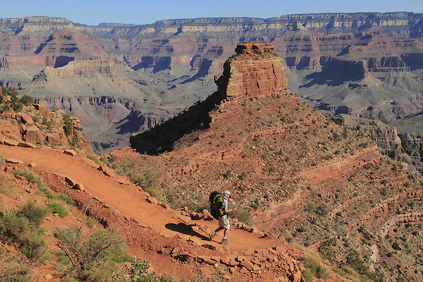 Hiker on the South Kaibab Trail descending Cedar Ridge, South Rim in Grand Canyon National Park, northern Arizona. .  John leads hiking and photo tours throughout Colorado. . John offers private photo tours in Grand Canyon National Park and throughout Arizona, Utah and Colorado. Year-round.