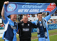 Gary Holt, Manager Peter Taylor and Matt Bloomfield celebrate Wycombe Wanderers winning promotion to Division One as they hold aloft a banner with the words, We're Going Up during Wycombe Wanderers vs Notts County, Coca Cola League Division Two Football at Adams Park on 2nd May 2009
