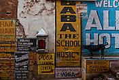 The various advertisements on the walls in the ancient city of Varanasi in Uttar Pradesh, India. Photograph: Sanjit Das/Panos