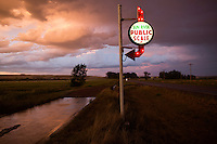 The sign for the Sun River Public Scale lights up in the evening outside of Sun River, Montana, USA.