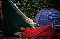 In this Saturday, Jun. 08, 2013 photo, a protester sleeps as he camps at night in Gazi park of Taksim Square during a 24/7 masive rally against the turkish government in Istanbul, Turkey. (Photo/Narciso Contreras).