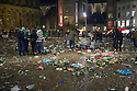 The clear up gets underway at Dam Square, Amsterdam after the Celtic fans party ahead of the game against Ajax.