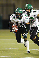 Corey Holmes, Neal Hughes, Saskatchewan Roughriders 2004. Photo F. Scott Grant