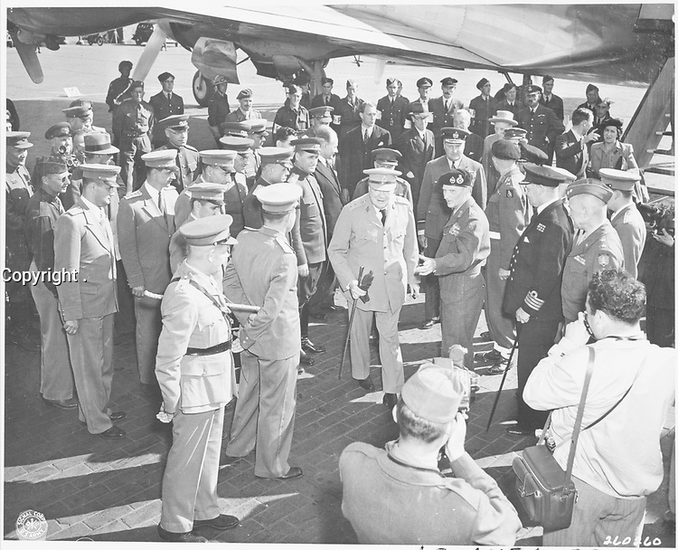 British Prime Minister Winston Churchill is greeted by Field Marshall Bernard Montgomery at Gatow Airport in Berlin,15 July 1945