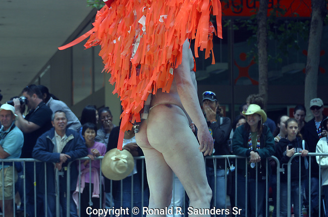 HALF NAKED MAN IN GAY PRIDE PARADE