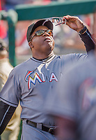 20 September 2015: Miami Marlins Third Base Coach and Assistant Hitting Coach Lenny Harris checks out a pair of glasses in the dugout during a game against the Washington Nationals at Nationals Park in Washington, DC. The Marlins fell to the Nationals 13-3 in the final game of their 4-game series. Mandatory Credit: Ed Wolfstein Photo *** RAW (NEF) Image File Available ***