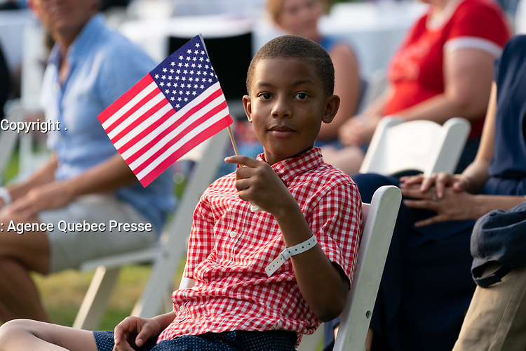 Salute to America 2020<br /> <br /> A young guest attending the 2020 Salute to America event waves an American flag as President Donald J. Trump delivers remarks Saturday, July 4, 2020, on the South Lawn of the White House. (Official White House Photo by Andrea Hanks)