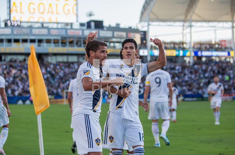 CARSON, CA - SEPTEMBER 29: Uriel Antuna #18 of the Los Angeles Galaxy celebrate's his goal with teammates during a game between Vancouver Whitecaps and Los Angeles Galaxy at Dignity Health Sports Park on September 29, 2019 in Carson, California.