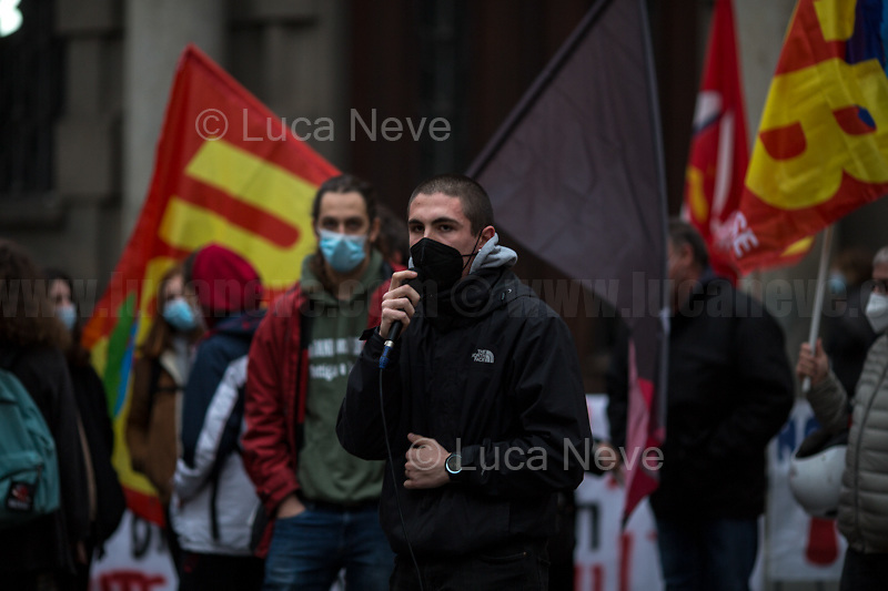 Rome, Italy. 12th Feb 2021. Today, the Trade Union USB, Potere Al Popolo Party, Rifondazione Comunista Party and other organizations of the non-parliamentarian Left held a rally (1.) outside the AIFA HQ (Agenzia Italiana del Farmaco / Italian Medicines Agencies, 2.), in Rome's Via del Tritone, to protest against the alleged capitalist/neo-liberalist management of the pandemic Covid-19/Coronavirus vaccines, alleged multinationals' speculations and their various interests in the pharmaceutical industry. Moreover, protesters called for free vaccines for the whole world population and that every State could have the opportunity to produce them autonomously nationalizing the pharmaceutical factories.<br /> <br /> Footnotes & Links:<br /> 1. http://bit.do/fNCKW <br /> 2. https://www.aifa.gov.it/en/home