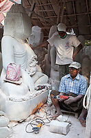 Myanmar, Burma, Mandalay.  Buddha Sculptors Carve, Sand, and Polish Buddhas from Stone.  Many are exported to China.