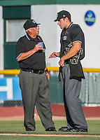 31 July 2016: Umpire Larry Riegert (left) chats with home plate umpire Dane Ponczak between innings of a Single-A minor league baseball game between the Connecticut Tigers and the Vermont Lake Monsters at Centennial Field in Burlington, Vermont. Riegert, working as an MiLB substitute, is also the Vice President of the Northern Vermont Baseball Umpires Association. The Lake Monsters edged out the Tigers 4-3 in NY Penn League action.  Mandatory Credit: Ed Wolfstein Photo *** RAW (NEF) Image File Available ***