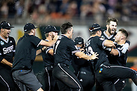Mississippi State Bulldogs celebrate walking off Game 4 of the NCAA College World Series against the Auburn Tigers on June 16, 2019 at TD Ameritrade Park in Omaha, Nebraska. Mississippi State defeated Auburn 5-4. (Andrew Woolley/Four Seam Images)