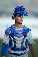 Midland RockHounds catcher Carson Blair (22) walks to the dugout from the bullpen before a game against the Tulsa Drillers on June 2, 2015 at Oneok Field in Tulsa, Oklahoma.  Midland defeated Tulsa 6-5.  (Mike Janes/Four Seam Images)