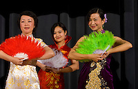 A group of young women dance in traditional Chinese attire during a Chinese New Year Celebration at UNC Charlotte in Charlotte, NC.
