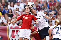 22 MAY 2010:  Germany's Kerstin Garefrekes and USA's Abby Wambach #20 during the International Friendly soccer match between Germany WNT vs USA WNT at Cleveland Browns Stadium in Cleveland, Ohio. USA defeated Germany 4-0 on May 22, 2010.